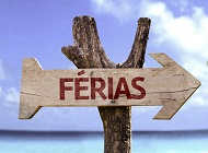 """Ferias"" (In portuguese - Holiday) wooden sign on a beautiful da"
